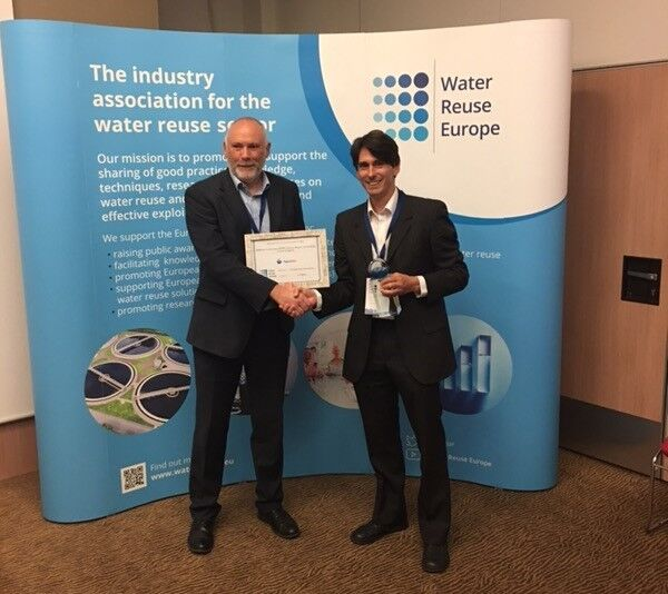 Paul Jeffrey (left), Chairman, Water Reuse Europe presents the Most Innovative Water Reuse Scheme award to Dan Brothwell, Development and Operations Manager, Aquabio Ltd | News Oct 17 Aquabio Wins Water Reuse Award