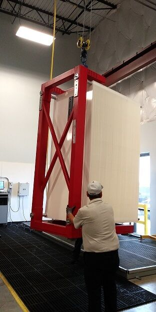 Fig 5: The finished module is lifted into the shower for quality control testing and finishing. | News May 18 Microdyn Opens Plant Fig 5A