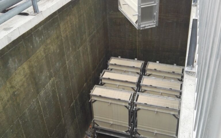 A photo of RisingSun membranes being installed in a tank onsite.